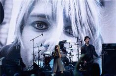 sid tone ‏@subsidtone   Photo of @KimletGordon fronting @Nirvana Iuso at the Rock & Roll Hall of Fame induction last night #Nirvana pic.twitter.com/Mi066eH88u