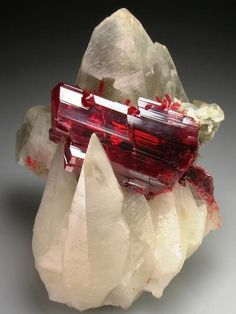 "The name ruby comes from the Latin word ruber, which means ""red."" The glowing red of ruby suggested an inextinguishable flame burning in the stone, even shining through clothing and able to boil water.  Ruby has been called the most precious of the 12 stones created by God."