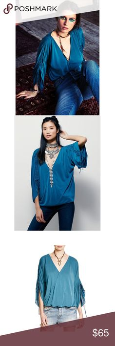 • Free People Salt N Peppa Jadé Top Size XS • Beautiful modal-blend top featuring a surplice neckline and adjustable sleeve ties for an effortless drape. Slinky, swingy fit in an overall relaxed body. Can fit small as well. No trades.   64% Modal 36% Polyester Trim: 100% Rayon Free People Tops