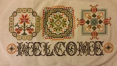 Welcome cross stitch. Pattern is from Rosewood Manor - Corners & Curves by Karen Kluba