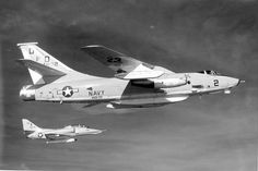 "A Tactical Electronic Warfare Squadron Thirty-Three (VAQ-33) Douglas ERA-3B ""Skywarrior"" Attack Aircraft, alongside a Fleet Composite Squadron One (VC-1) Douglas TA-4J ""Skyhawk"" trainer attack aircraft north of Oahu, Hawaii."