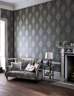 Florentine from Harlequin's Leonida wallcovering collection is a dramatic oversized ogee which is enhanced by beading and metallic inks.