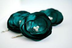 Emerald Green Bridesmaid Hair Flowers (3 pcs) Wedding Bridal Hair Flowers Satin White Pearls Bridal Hair Accessory. $18.00, via Etsy.