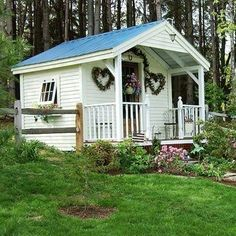 Love this one...the heart wreaths and railings on porch, and little flower garden.............~~~~~~~~~~~jeje