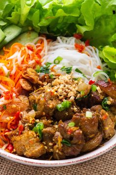 Our Bun Thit Nuong has rice noodles topped with fresh herbs, pork and a sweet and sour dipping sauce. Prep in advance for an easy meal! #noodlesalad #vietnamesenoodlesalad #porknoodlesalad Marinated Pork, Grilled Pork, Vietnamese Noodle Salad, Vietnamese Recipes, Pork Noodles, Rice Noodles, Thit Nuong Recipe, Asian Noodle Recipes, Pork Salad