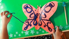 Doing a String Design Butterfly Art Project - pull off the string