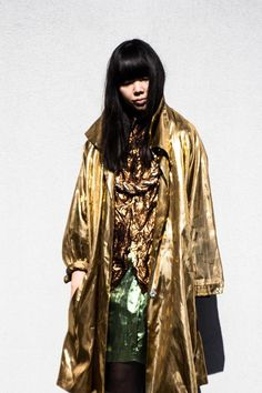 Susie Bubble in a metallic raincoat.