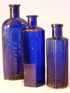 A wonderful set of three antique cobalt blue poison bottles To distinguish them from non-lethal products, poison bottles were made unique and dramatic in color, texture and shape. Colors like cobalt blue, honey amber, black, and emerald and several other shades of green were used to ensure they stood out from the other bottles on the shelf.
