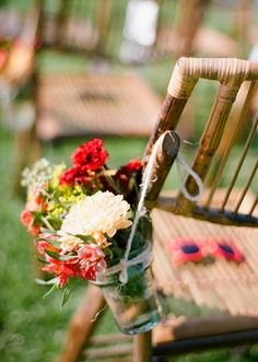 Outdoor Wedding Ideas: Provide sunglasses on each chair for guests. Hang jars filled with bouquets on the end chairs as aisle decor. | Destination Wedding in Sayulita, Mexico at Don Pedro