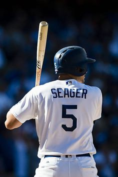 Corey Seager of the Los Angeles Dodgers bats against the Washington Nationals during the fifth inning in game three of the National League Division...
