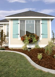 Window boxes and teal shutters add a beach feel to this Tri-Cities cottage Interior Design And Construction, Cottage Style Homes, Tri Cities, Window Boxes, Exterior Colors, Shutters, Custom Homes, Washington, Shed