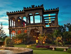 A once great mansion stands in stately ruin Talisay Philippines