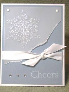Snowflake Spot, The Paper: White, Bordering Blue, Vellum Ink: Craft White Accessories: Heat & Stick, Dazzling Diamonds, Brads, Ribbon, Bling Techniques: Stamping, Embossing