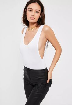 Save your dolla for new season treats! Be a basic babe and don't break the bank in this white bodysuit with a scoop back and drop armhole style.