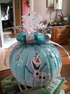 Frozen inspired ombre pumpkin with Olaf on it, and a crystal snowflake topper.