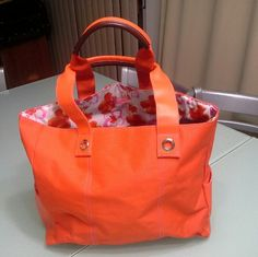 Lancome Tote Big tote in orange parachute material with printed interior.  Handles are msde up of leather. Side pockets.  Almost new condition. Lancome Bags Totes