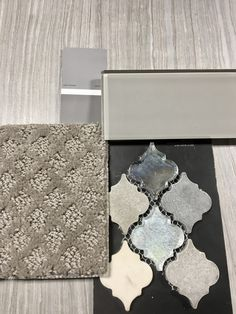 This weeks pretty pick shows a grey glass subway tile that we would suggest for the shower walls. We paired it with a linear porcelain tile for the floor, and added some flare with the mixed lantern mosaic. To carry this simple (yet elegant) design into the adjoining rooms, we've included a stunning marquis style carpet that plays beautifully with the accent tile.