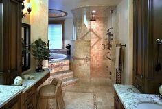 Mediterranean Master Bathroom with flush light, frameless showerdoor, limestone tile floors, Handheld showerhead, Flush