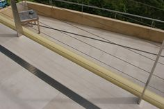 Infinity Drain AG 65 Series along a suspended balcony.