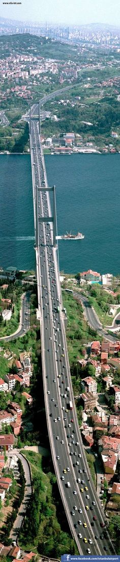 Bosphorus Bridge Istanbul. It is 1,510 m (4,954 ft) long with a deck width of 39 m (128 ft). The distance between the towers (main span) is 1,074 m (3,524 ft) and their height over road level is 105 m (344 ft).  Went under in 1989; when Russia was still cranky.