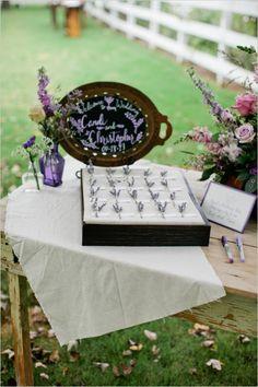 reception welcome table and guestbook #lavenderwedding #purplewedding #weddingchicks http://www.weddingchicks.com/2014/01/01/lavender-wedding-2/