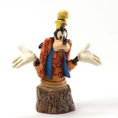 Lovable ol' Goofy is never sure of anything, but we're sure we love him! GOOFY - CARVED BY HEART (Jim Shore Disney Traditions)