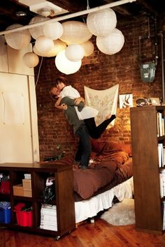 paper lanterns, book self as a wall, exposed brick