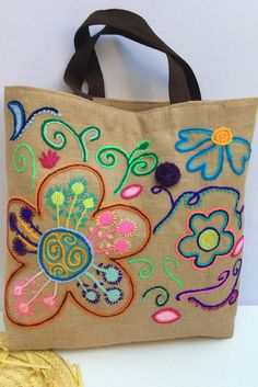 Vibrant floral Jute Tote Beach Bag Perfect for any summer outing, elegantly designed jute tote . Hand embroidered with bold bright flowers . This is a very unique , stylish contemporary classic jute tote bag for the spring/summer/autumn season. Make a statement by carrying it in the city or