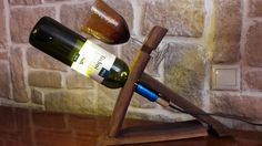 Bottle and glass holder from wine barrel parts
