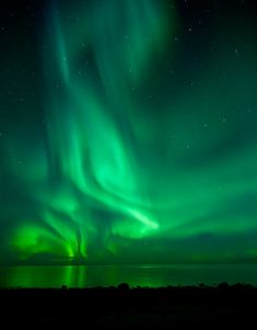 A powerful outburst of auroras over the open sea at Eggum on the Lofoten islands in Norway