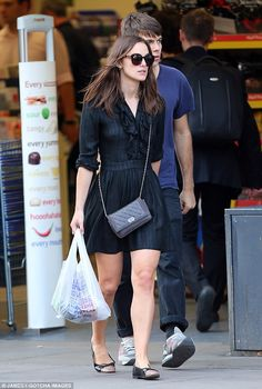 Back to black: Keira Knightley looked chic in a black dress and matching Chanel accessories as she headed out in London with James Righton on Thursday