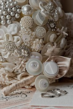 The Duchess Button Bouquet  This gorgeous bouquet is one of my favourites, one of my Premium Bouquets finished to the highest standard, fit for a duchess !   Approx 100 stems of buttons from around the globe, many vintage glass, sitting side-by-side sweet hand sewn flowers, turkish lace work flowers, glass and rystal pearl clusters, divine diamonte buttons, and more.  A very vintage finish of doileys, although I am happy to chage this to a satin petal finish if youd prefer.  458.00