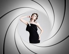 You worked hard to look this good. Capture the night with a Bond themed photo booth. The bullet hole graphic is a classic or consider a simple backdrop with fun Bond props such as toy guns, fake knives, and real martinis. See more ideas for planning your own Casino Royale theme party at www.sparklerparties.com/casino-royale