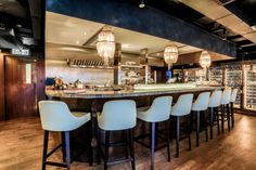 CVCHE seafood restaurant in Central, Hong Kong designed by Liquid Interiors. restaurant design, commercial spatial design, bar design, bar counter top, wood and glass, simple and modern, jellyfish lgihts, open kitchen, seafood restaruant