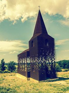 Certainly not your run-of-the-mill place of worship, the facade of a church in Borgloon, Belgium, is a rare, visual treat—appearing whole. Architecture Design, Amazing Architecture, Landscape Architecture, Archi Design, Chapelle, Place Of Worship, Land Art, Kirchen, Installation Art