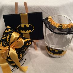 Fun bridal set, Batman themed. Includes a garter, guest book, flower girl basket and ring pillow. You save $12 by purchasing as a set all my