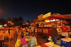 Dining at Tahiti's waterfront food trucks, Les Roulottes.