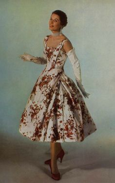 1955 Model in silk floral print dress by Madeleine de Rauch, photo by Georges Saad