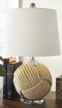 Consider a touch of coastal chic: Our Nautical Portland Lamp brings intriguing texture and a welcome touch of seaside ambience anywhere you choose to brighten things up.