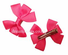 Cerise pink grosgrain ribbon hair bows on alligator clips - £2.50 a pair from www.dreambows.co.uk  pink hair bows, grosgrain ribbon hair bows, hair clips, hair slides, plain pink hair bows, uk hair bows, uk handmade hair accessory bows, accessories for girls, girls hair bows, alligator clips, crocodile clips