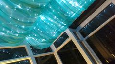Conservatory lighting - fairy lights plus voile and curtain wire, plus a bit of sewing!
