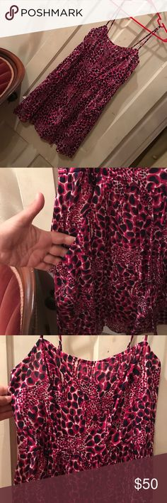 Lilly Pulitzer spaghetti strap dress Pink and purple Lilly dress with giraffes. Smocked in back WITH POCKETS! Super cute, I just don't like how it fits me. Lilly Pulitzer Dresses