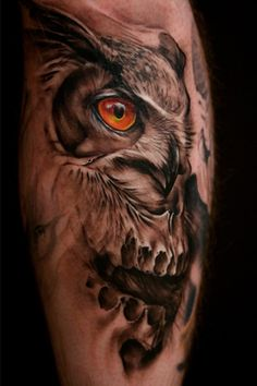 I really like the concept of a black and grey tattoo with the splash of color like the owl's eye