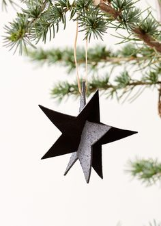 Handmade christmas ornament made as a black star in leather. Hight: 9 cm (without suspension), 16 cm (with suspension)