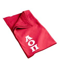 Alpha Omicron Pi blanket with white Greek letters available in several colors. Shop the #AlphaOmicronPi collection at M&D Sorority Gifts. 300+ items. #aopii