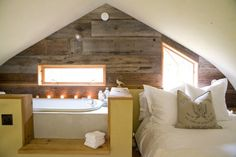 Amazing Barn Transformation Into A Cozy Modern House | DigsDigs - i like bed and bath all together in main bedroom, also like lots of natural light
