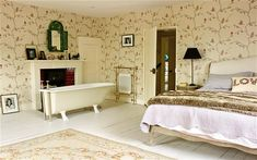 With its white-painted floorboards, pale carpet and cream-backround English Robin wallpaper, the master bedroom has a bright, airy feel. Bedroom With Bath, Small Room Bedroom, Small Rooms, Master Bedroom, Painted Floorboards, White Floorboards, The Woman In White, Clawfoot Bathtub, Provence