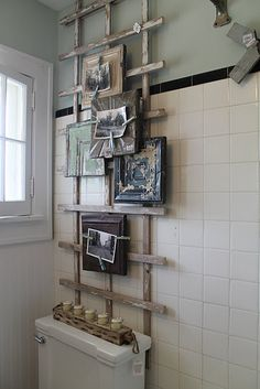 photo holder made from an old garden trellis, ceiling tin and magnet clothespins
