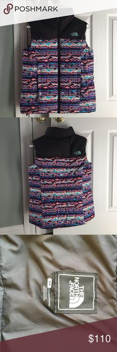 North Face Vest Size- Small, two external zipper pockets, one internal breast pocket, two bungee adjustable cords, new without tags, from a pet and smoke free home. The North Face Jackets & Coats Vests