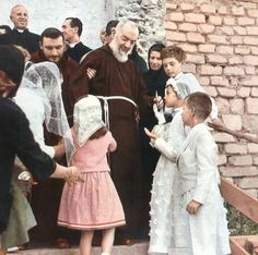 "This photo shows a number of children greeting Padre Pio on the day of their first Holy Communion. Padre Pio had a great hunger for the Eucharist. He spent long hours before Jesus in the Blessed Sacrament, sometimes whole nights. He would say to those who asked for his prayers, ""I will ask Jesus in the Blessed Sacrament when I am near the tabernacle."""